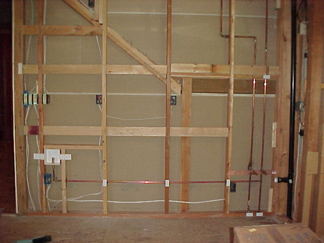 complete view of wet bar area showing the icemaker supply line
